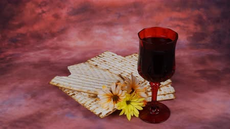 yahudi : Passover background. wine and matzoh jewish holiday bread over wooden board. Stok Video