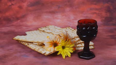 vallási : Passover background. wine and matzoh jewish holiday bread over wooden board. Stock mozgókép