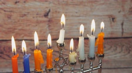 menorah : Lighting Hanukkah Candles Hanukkah celebration Stock Footage