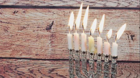 премия : Lighting Hanukkah Candles Hanukkah celebration Стоковые видеозаписи