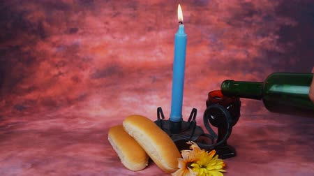 подсвечник : Lit Shabbath candles with uncovered challah bread