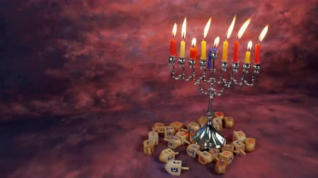 okładka : Jewish holiday Hanukkah creative background with menorah. View from above focus on .