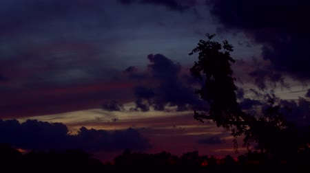 bulutluluk : Dramatic dark clouds at sunset. . Color toned. Stok Video