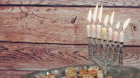cabeçalho : Jewish holiday Hanukkah creative background with menorah. View from above focus on .