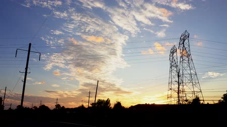 pilon : 4K. Timelapse of Silhouette electricity pylons in sunset background - ULTRA HD,