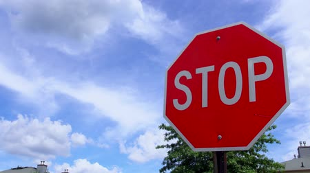 caution sign : Stop sign with fast moving clouds Stock Footage