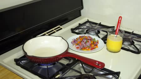 fried : omelette with red and green peppers and onions on white plate