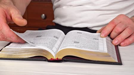 verse : Man reading from the holy bible, close up Stock Footage