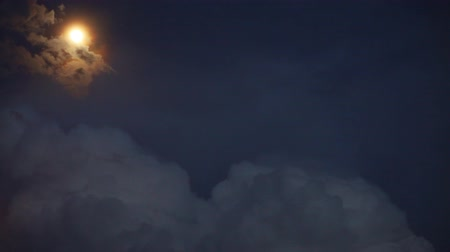 marcante : Dramatic Moon orbit planet Earth. lightnings in sunset sky with dark clouds