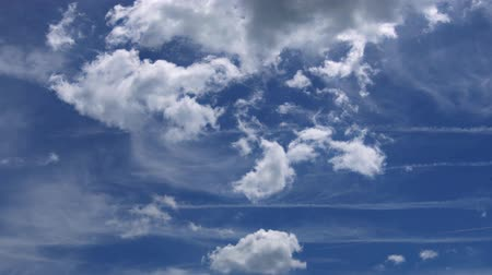 White clouds flying on blue sky with sun rays 4K video resolution