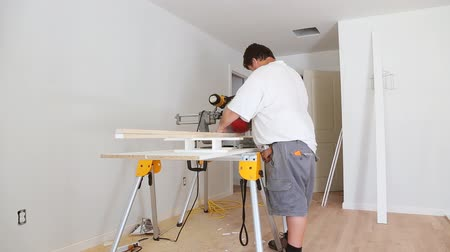 Miter Saw on a construction site with a worker in contractor uses a circular saw to cut and trim Dostupné videozáznamy