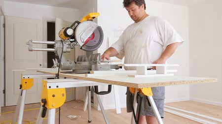 timber cutting : Construction worker remodeling home Carpenter cutting wooden trim board on with circular saw.