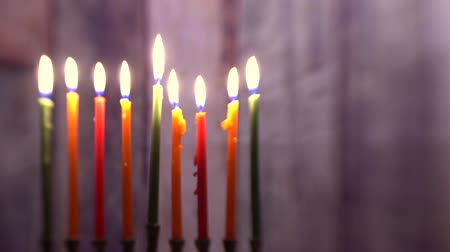 menorah : Burning hanukkah candles in a menorah on colorful candles from a menorah Selective soft focus