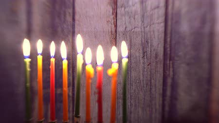 judaizm : Menorah with candles for Hanukkah against defocused lights Selective soft focus,