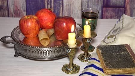 tallit : rosh hashanah jewish holiday concept shofar, torah book, honey, apple and pomegranate. traditional holiday symbols.