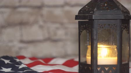 veterano : Lighted candle with an American flag, background Stock Footage