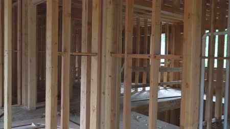 dach : Interior framing of a new house under construction Wideo