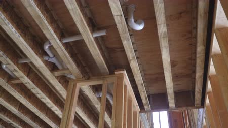 truss : Close-up new stick built home under construction under blue sky Framing structure wood frame of wooden houses home. Stock Footage