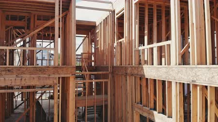 truss : Residential Home Construction Site Framed Close Up a wide shot of a new home construction with some framed wall up