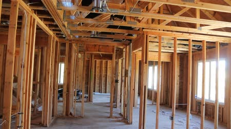 truss : Interior framing of a new house under construction Stock Footage