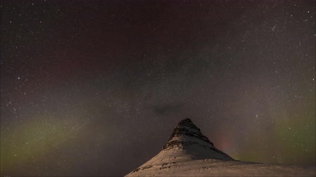 Timelapse Snowy mountains with aura in Norway
