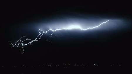 electric strike : Extreme lightning storm timelapse over.Thunderstorm in the city center Stock Footage