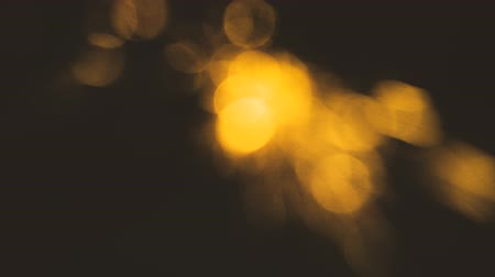 ás : Blurry moving defocused gold lights on black background loop Stock Footage