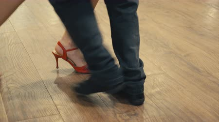 füstös : Dancing latin dance. Close-up of legs dancing tango.