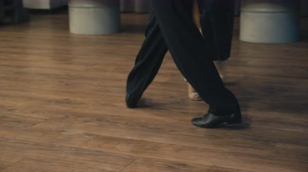 társ : Dancing latin dance. Close-up of legs dancing tango.