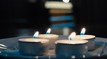 grieved : small candles floating in the darkness warm tones