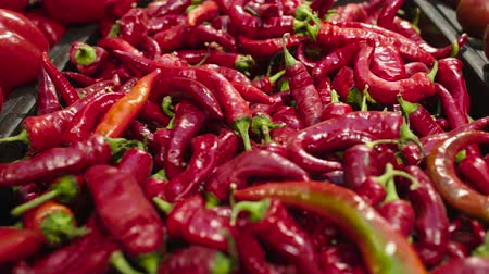 ветчина : Fresh Raw hot red pepper in a counter of market Стоковые видеозаписи