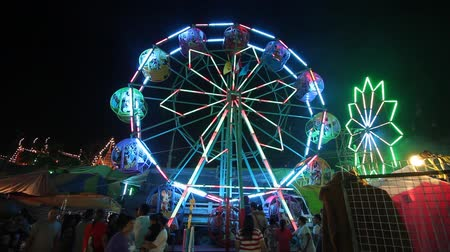 samut : Samut Prakan-THAILAND : October 25, 2015 People and Colorful ferris wheel on nightlight in amusement park.