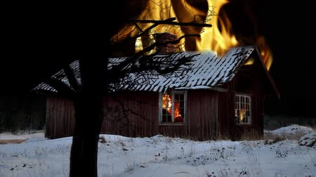 сжигание : Small wooden shack on fire in winter evening