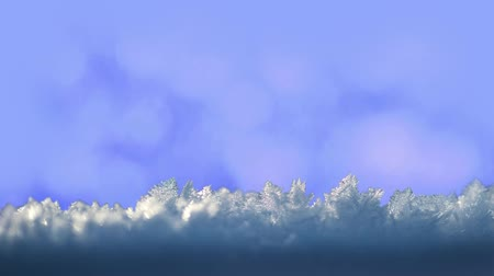 Ice crystals on abstract blue background