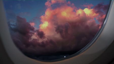moving clouds seen through airplane window
