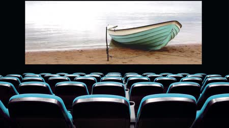 cinema with moored boat on screen