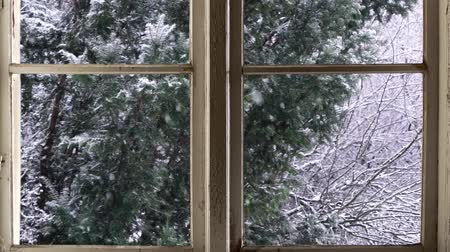 Heavy snowfall seen through old wooden window Stok Video