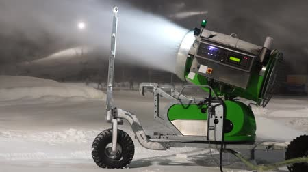 holiday makers : Snow machine in ski slope at night