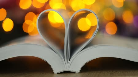 biblia : Book page decorate to heart shape with celebration bokeh light for love and romance of valentines day concept , 4K Dci resolution