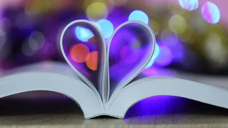 Book page decorate to heart shape with celebration bokeh light for love and romance of valentines day concept , 4K Dci resolution