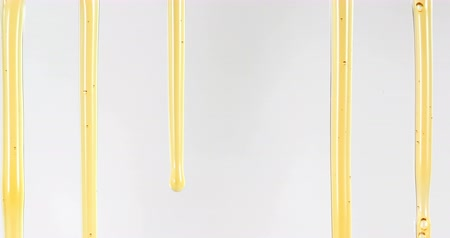 Close up golden sweet honey dripping line on white background , 4K Dci resolution