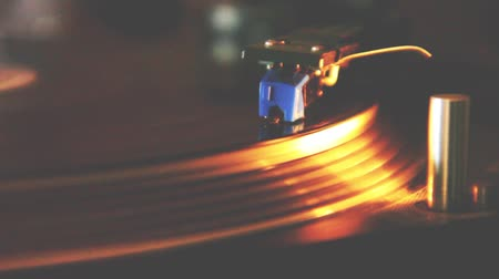 Electronic music played by a vinyl record player: The DJ plays in the dance hall.