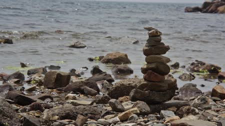Peace and meditation symbolized by a pile of rocks on the beach: Zen symbol.