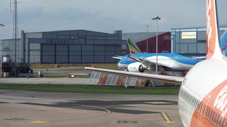 pushed : MANCHESTER, UK - 9TH APRIL 2019: A TUI aircraft is taxiing onto the Runway at Manchester Airport