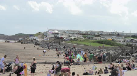 holiday makers : HORNSEA, UK - 7TH AUGUST 2019: Tourists and holiday makers flock to the sandy beaches of Hornsea to enjoy the hot summer weather.