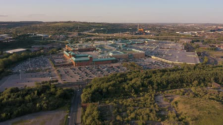 otoyol : SHEFFIELD, UK - 13TH AUGUST 2019: Aerial vertical reveal of the M1 and Meadowhall in Sheffield, South Yorkshire, UK during Sunset