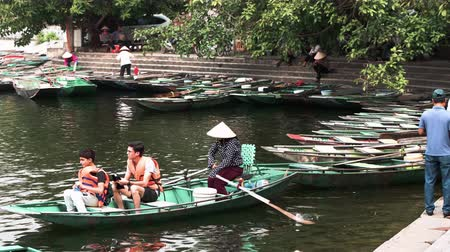 tam coc caves : Ninh Binh, Vietnam - 19th October 2019: Tourists take boat tours from Ninh Binh in Northern Vietnam