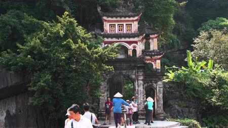 ninh : Tam Coc, Vietnam - 20th October 2019: Bich Dong Pagoda entrance and tourists in Autumn