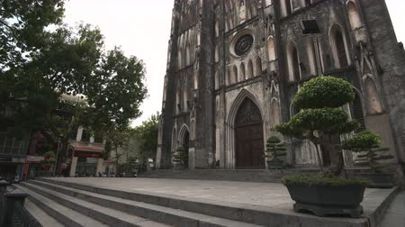 ha : Hanoi, Vietnam - 23rd October 2019: St Josephs cathedral in Hanoi, the large Roman Catholic structure in Vietnams capital Stock Footage