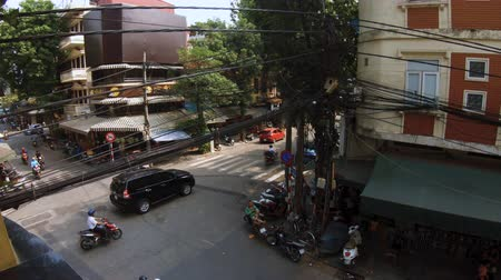 Hanoi, Vietnam - 10th October 2019: Busy street corner in Hanoi recorded from a coffee shop above